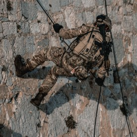 ROYAL MARINES OF 43 COMMANDO TRAIN ON THE FAMOUS ROCK OF GIBRALTAR Pictured: Royal Marines of P Squadron, 43 Commando, conduct Vertical Assault training under the watchful eye of Mountain Leaders, the Royal Marines mountain warfare specialists, in preparation for cliff assaults and abseil extractions that will be conducted at night later in the exercise. Royal Marines from Scotland-based 43 Commando Fleet Protection Group have taken part in demanding training exercises on, and within, the Rock of Gibraltar, perfecting techniques they use in their top-secret mission as the elite guardians of the United Kingdom's strategic nuclear deterrent. Over 80 of these highly trained Commandos spent 2 weeks in early November on Exercise Serpent Rock honing the skills necessary for their no-fail mission protecting the Nation's nuclear assets. This annual exercise sees the Royal Marines making best use of Gibraltar's unique terrain, undertaking amphibious and cliff assaults, close quarter battle in urban environments and within the network of tunnels the Rock is famous for, as well as patrolling its streets, thoroughfares and the narrow alleyways and passages that pepper this British overseas territory.