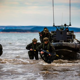 Pictured are members of Alpha Company, 40 Commando Royal Marines during their amphibious insertion by Offshore Raiding Craft (ORC) from RFA Lyme Bay during Exercise Joint Warrior. April 29, 2018.