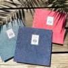 livre d'or rose corail, bleu marine et gris vert