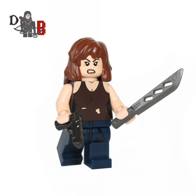 """This custom designed Minifigure is based upon Maggie Greene from the popular Walking Dead Series. Includes Maggie's machete and pistol. The chest has been professionally machine printed using my own design. Made using genuine LEGO parts except for the machete and pistol which are professionally custom made. Each minifigure is carefully packaged into a re-sealable bag and shipped in a bubble lined envelope for extra protection. """"LEGO® is a trademark of the LEGO Group of companies. The LEGO Group does not sponsor, authorise or endorse the modified/customised product(s) shown nor does it accept responsibility in any way, shape or form for any unforeseen and/pr adverse consequences following from such customisation/modification."""""""