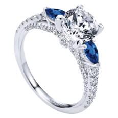 Romantic blue sapphire accented diamond engagement ring