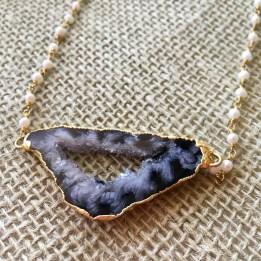 Goldtone geode necklace $246