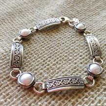 Sterling bracelet with flower details $110