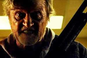 rutger hauer with a shotgun