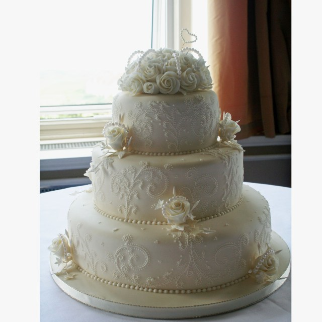 Wedding Cake Pearl Decorations Pearl Wedding Cake Decorated With Detailed Lace Embroidery And Pearls