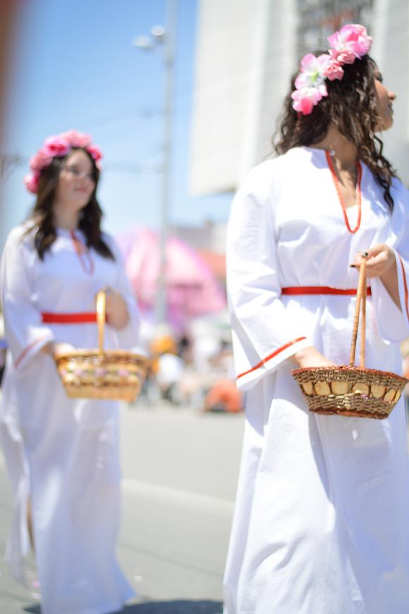 Girls picking up roses during the Rose festival in Kazanlak