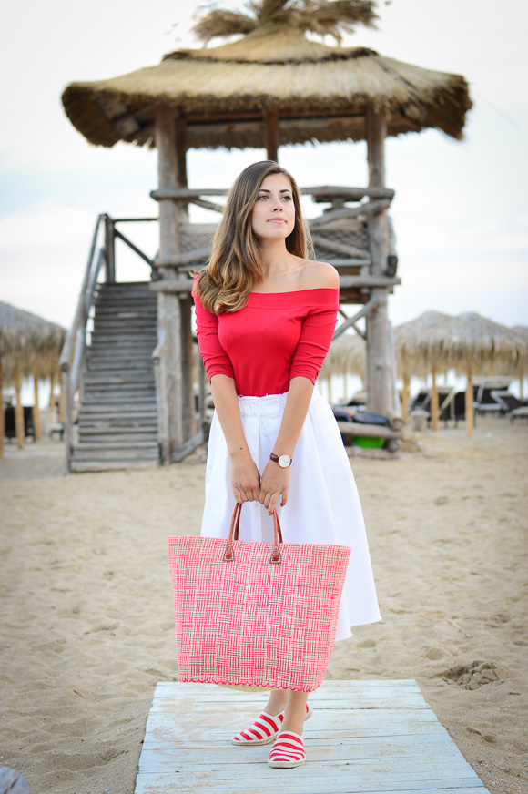 Denina Martin wearing Red Striped Espadrilles and a Straw Bag by the Beach
