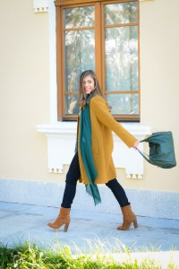 Comfy mood in a mustard coat and emerald green accessories