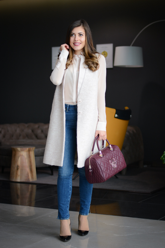 Fashion Blogger Denina Martin sharing how to style a sleeveless coat