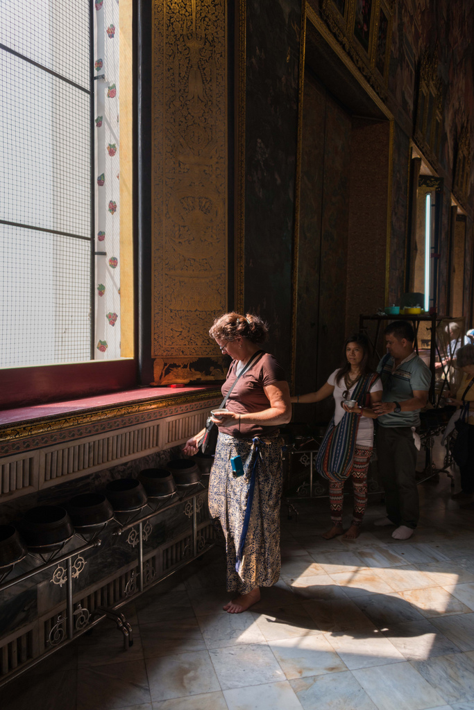 Next to the reclining Buddha in Wat Pho, one can buy a few dozen coins that then should be thrown into buckets that are lined up along the wall. This offering gives you good Kharma.