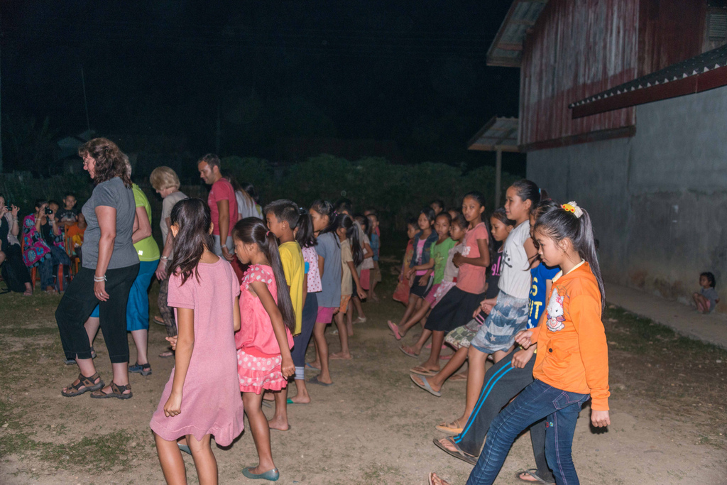 ... but soon everyone was participating in a traditional Lao dance.