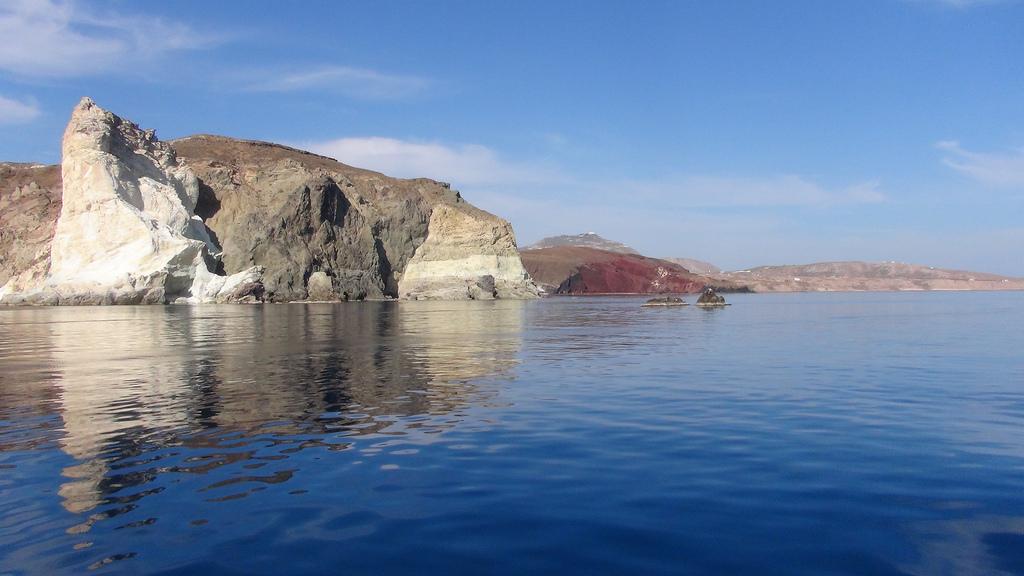 The multi-layered colored rocks of the Thira coast.