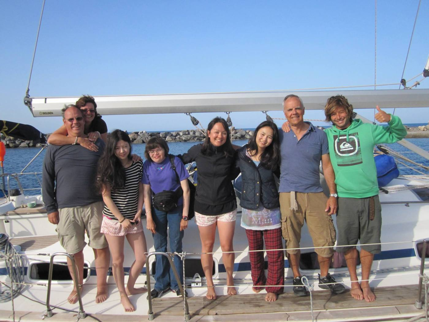 The crew of the Greece sailing adventure: Karel, Denise, Tina, Andrea, Row, Xin, Paul, and skipper Andre.