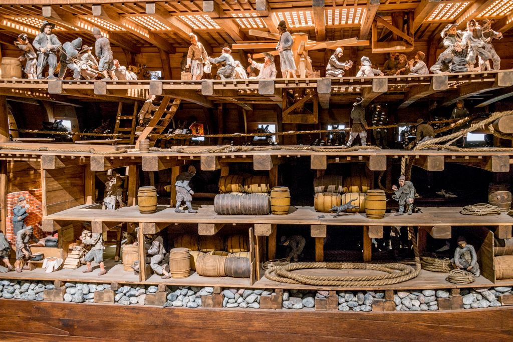 A model cross-section shows the Vasa with crew and cargo on her maiden voyage.