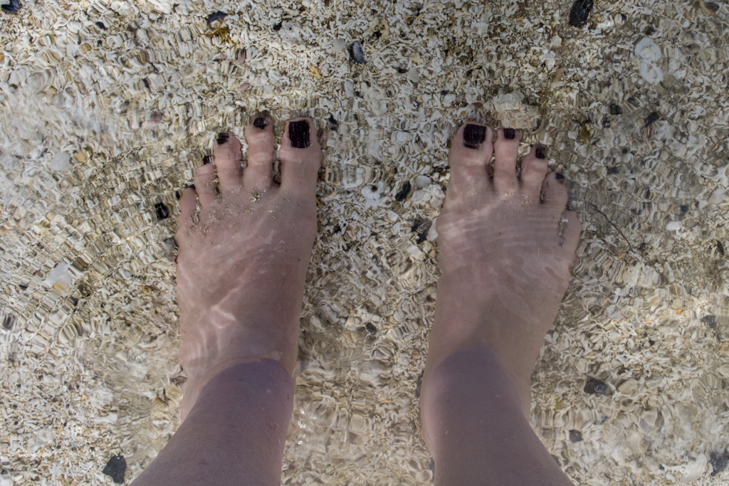 Pegs took a picture of her feet, then realized the water was so perfectly, perfectly clear, it's practically invisible.