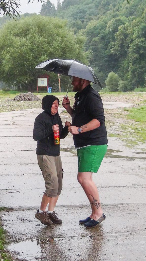 Yolanda and Stephen trying to warm up during our long wait in the rain.
