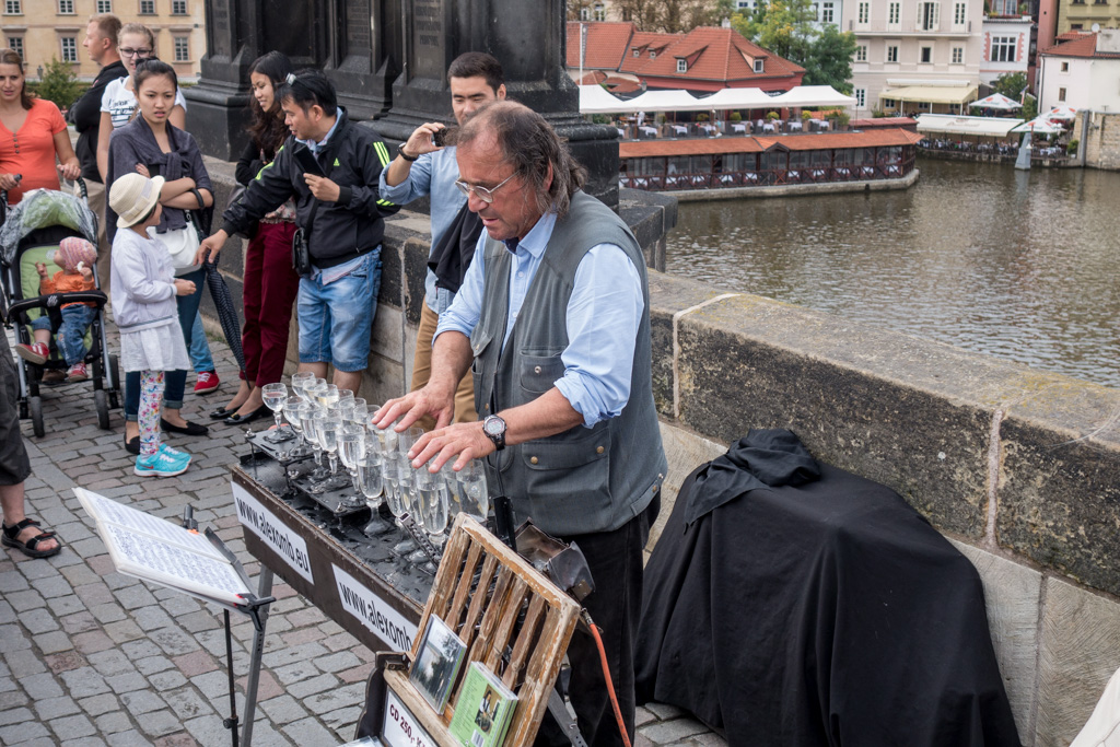 The Charles Bridge is lined with troubadors. This man played Vivaldi using water-filled crystal goblets.