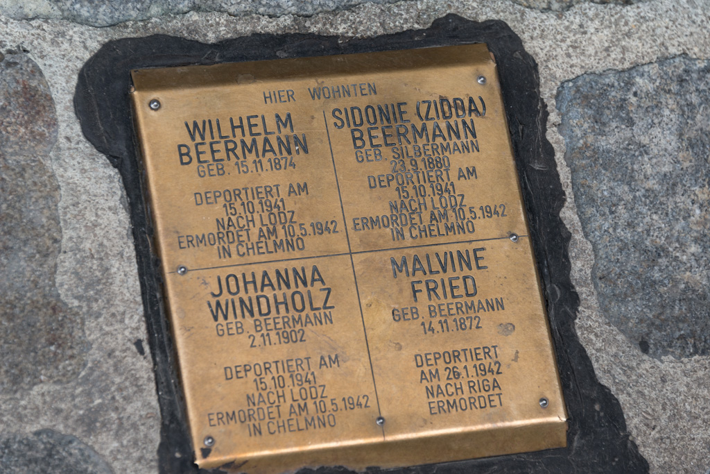 These monuments, remembering Jews killed during the Holocaust, dot the city sidewalks.