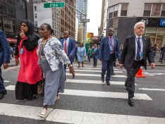 NEW YORK USA - Sep 20 2016: New York and New Yorkers. Manhattan street scene. The Americans on the streets of New York City. People go to work early morning