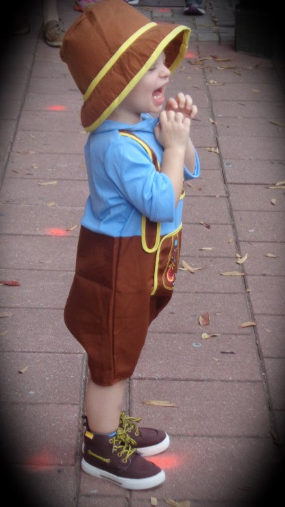 Child having a great time in his little liederhosen costume