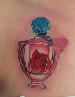 Tatuaggio boccetta di profumo