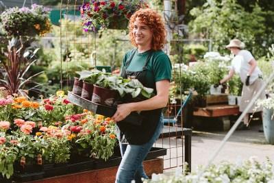 garden center worker holding plants
