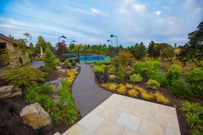 paved pathway to tennis court