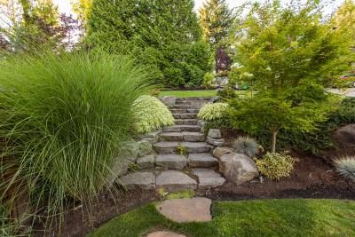 stone steps with ornamental grasses
