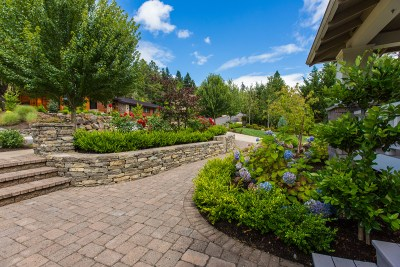 residential landscaping hardscape path with hydrangeas and roses