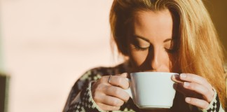 Woman sipping on coffee
