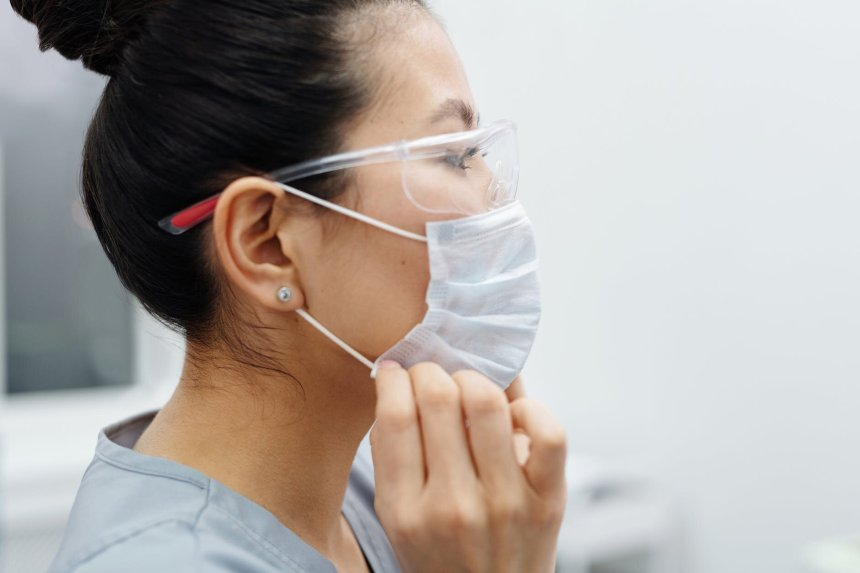 photo of woman wearing protective mask