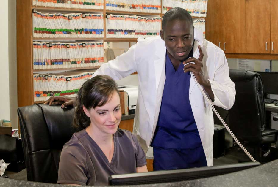 Dentist and office manager calling DentiMax for dental software customer support.