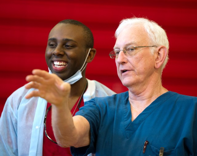 Junior Osinde, left, talks with Dr. Stephen Crane during Operation Lone Star in Mission, Texas, in August 2014.
