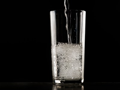 A water glass filled with water