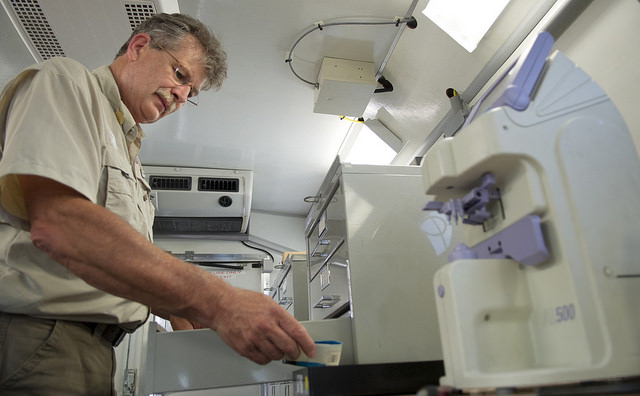 Jeff Eastman, Remote Area Medical Employee and volunteer, prepares a set of lenses in the vision truck.