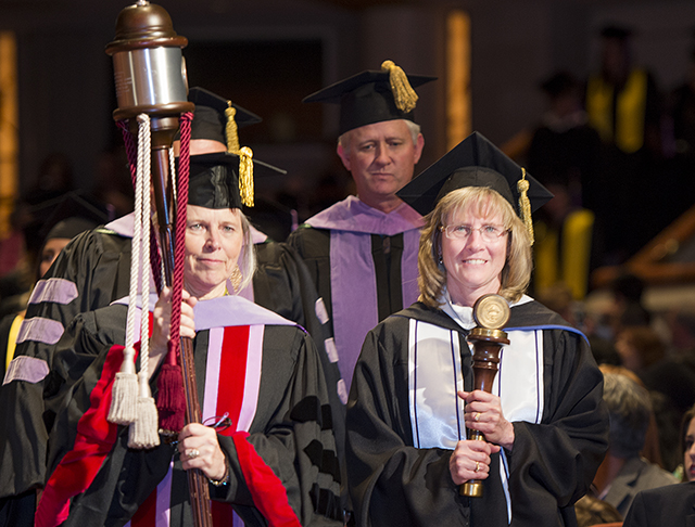 Teacher of the Year recipients Dr. Kay Mash and Kathleen Muzzin at 2015 commencement exercises