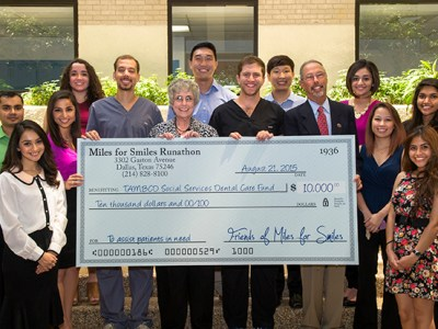 Organizers of the 2015 Miles for Smiles present a check to TAMBCD administrators