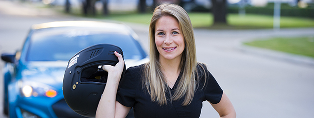 D4 Anika Rodgers with her car and a motorcycle helmet