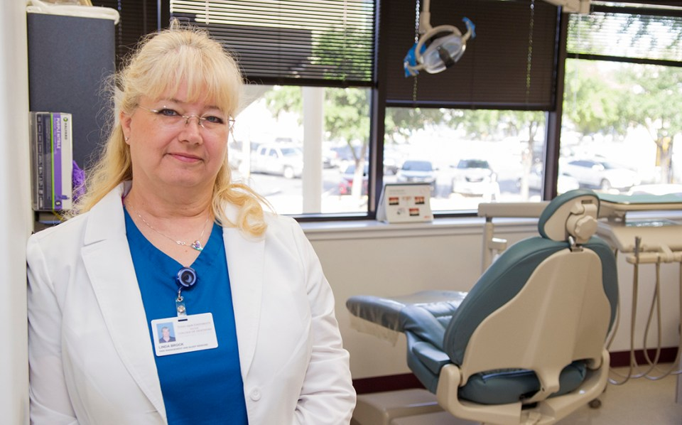 Linda Brock, program coordinator, stands in the clinic at the Center for Facial Pain and Sleep Medicine