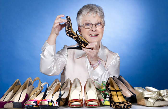 "Moira Allen's passion for footwear isn't exactly a secret. A mere glance in her office reveals some subtle giveaways: shoe stickers on her file cabinet, a tape dispenser shaped like a shoe and — during the holidays — a stocking hung on her office door with care, glittery heel and all. In all those years of wearing heels, Allen — whose late husband had to convert a linen closet just to store the collection — can't recall one mishap, stumble or fall. Her feet never get sore. And kitten heels; forget it. ""I don't like little teeny, tiny heels,"" Allen says. ""But I wonderfully love a good pair of shoes."""