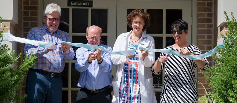 Paul Hoffmann with the dental school, second from left, along with Dr. Barbara Stark Baxter, founder, and Stephanie Bohan, executive director, during the ribbon cutting on June 25.