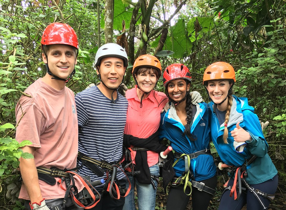Five people prepare to go on a zipline in Ecuador.