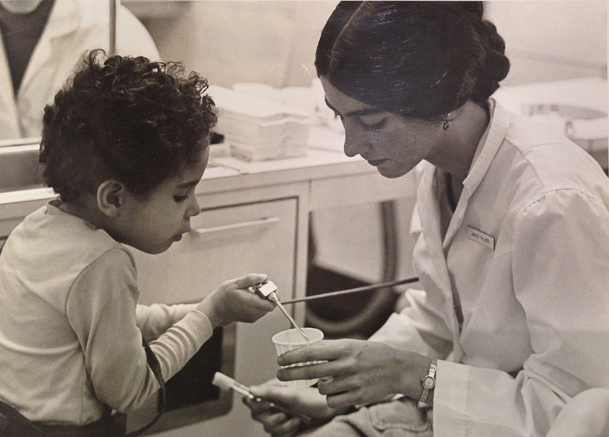 Dr. Janice DeWald, then a first-year dental hygiene student at the University of Iowa College of Dentistry, with her first pediatric dentistry patient