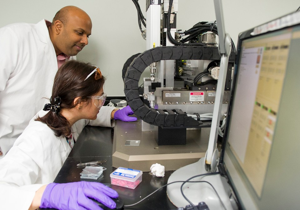 Dr. Venu Varanasi and Research Assistant Tugba Cebe set the coordinates for the 3-D printer.
