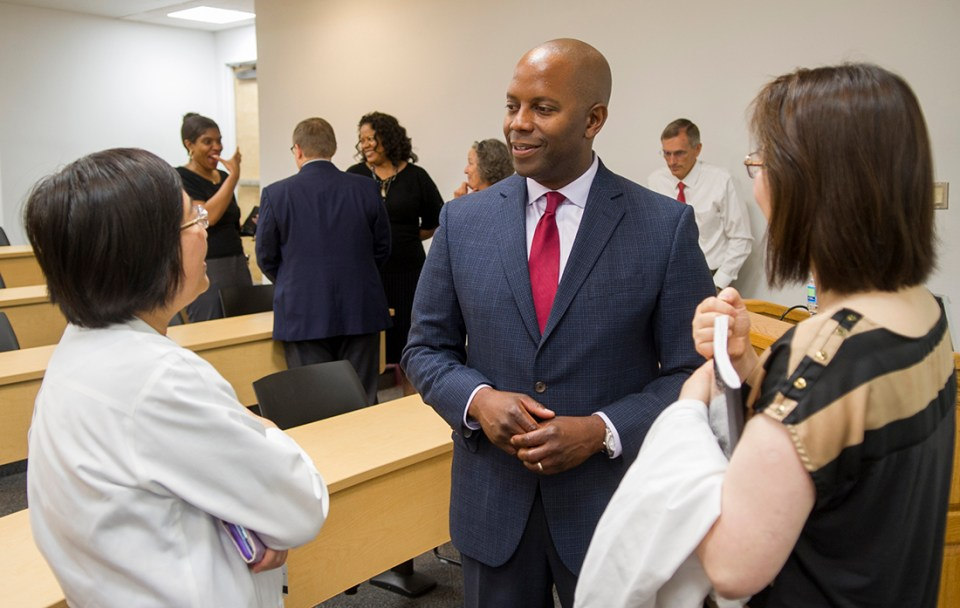 Williams speaks with Texas A&M College of Dentistry faculty members on June 21.