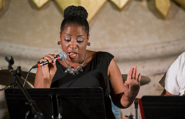 "LaDawn Brock, marketing, web and media relations manager, sings ""Loco-motion"" during the Nov. 17 Agape benefit concert."