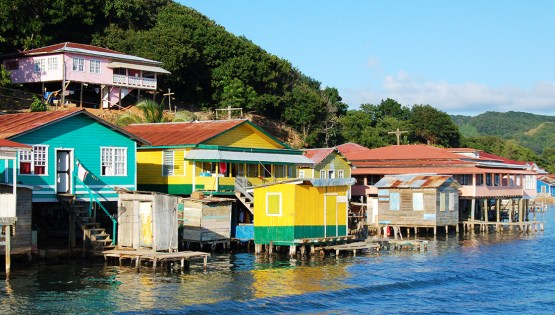 Houses built on stilts along the coast of Roatan, Honduras