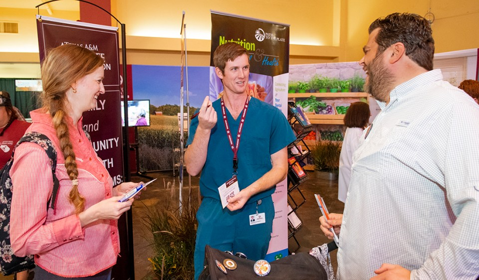 D3 Brendan Daugherty visits with fairgoers on Sept. 28.