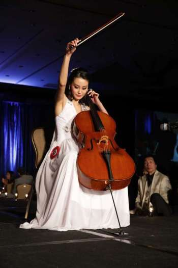 Hours of practice with the cello led to this moment during the July 21 pageant. Photo: Alvin Gee.