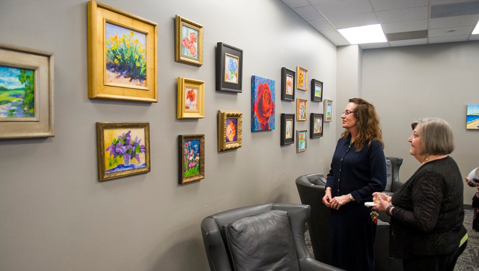 """Dr. Ann McCann, left, with her close friend and colleague Pat Campbell, professor and executive director of dental hygiene, at the February 2016 opening of """"The Color of Memories"""" exhibit featuring McCann's artwork at the Baylor Health Sciences Library"""